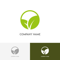 Nature logo - fresh green leaves on the white background