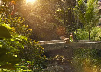 Pacific Islander woman on walkway in jungle
