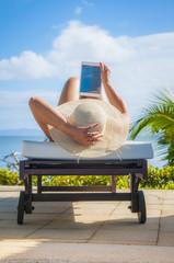 Hispanic woman using digital tablet outdoors