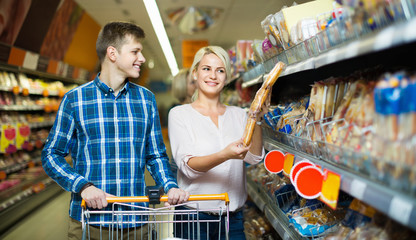 Young family looking at assortment of bread