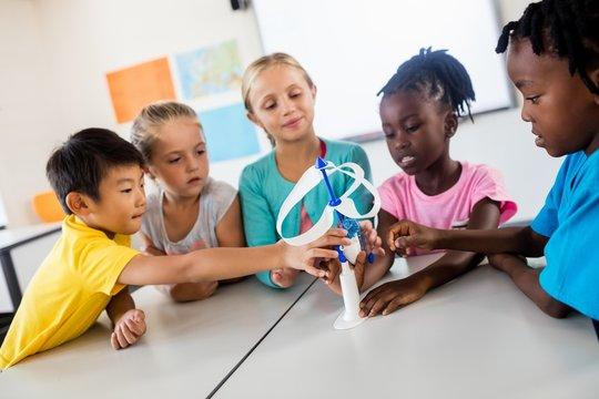 Pupils using wind turbine model