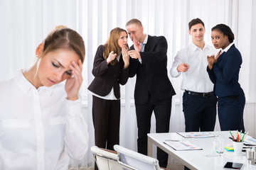 Stressed Female Colleague In Office