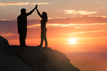 Silhouette Of A Couple On Hill
