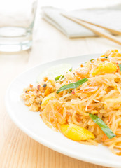 Pad Thai or Thai Fried Noodle on Wood Table with Napkin Chopstic