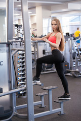 Beautiful young girl engaged fitness in the gym.