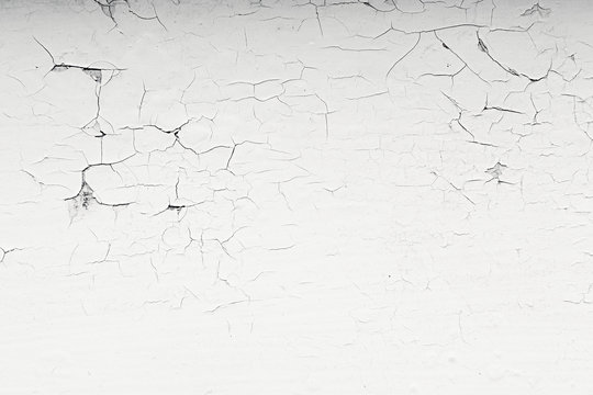The old white paint. The cracks texture. The background.