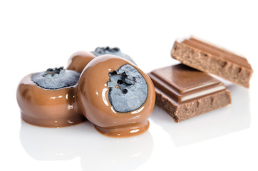 Chocolate candy with blueberry isolated on white