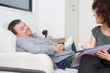 Cheerful man on reception at female psychologist