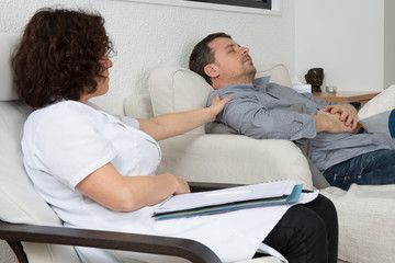 Therapist comforting his upset patient at therapy session