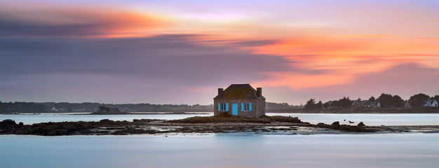 House on the water in Saint Cado, Brittany, France Wall mural