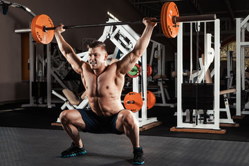 Muscular man  lifting a barbell
