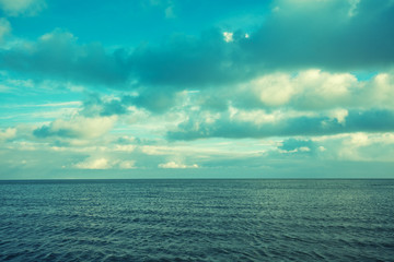 Sea with cloudy sky. Blue toned
