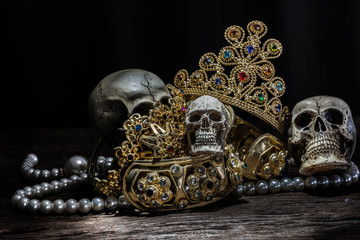 Still life Skull with Treasure Gold jewelry, pirate concept.
