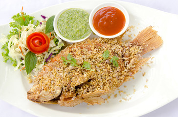 Deep Fried Red Tilapia with Garlic and Pepper, Thai food.