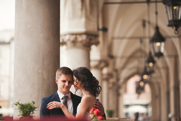 Wedding couple, man, girl sitting in cafe smiling and kissing