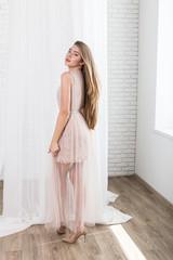 Fashion studio portrait of beautiful young fair hair woman
