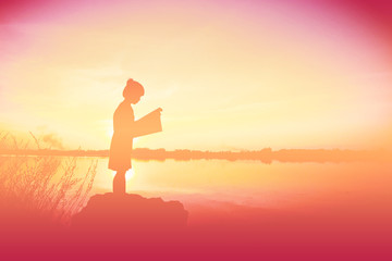 silhouette children reading book time at sunset