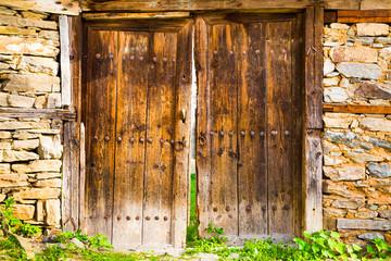 Old double rustic wooden barn doors