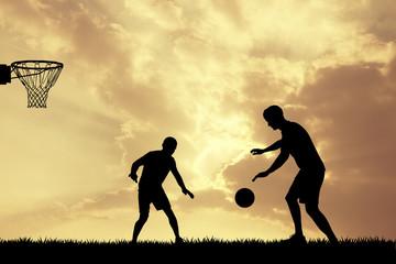 men playing basketball at sunset