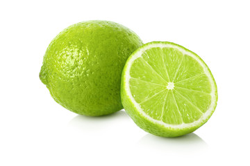 Ripe lime with a half on white background
