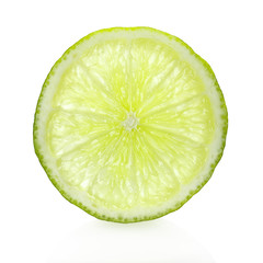 Ripe lime slice on white background