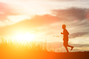 silhouette of boy running