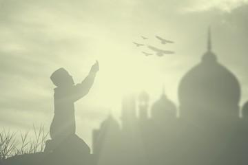 Silhouette muslim boy praying faith in allah God of islam suprem