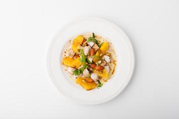 Salad with chicken, orange, arugula and pumpkin seeds