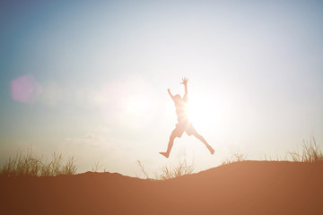 little boy jumping and having happy time, Sillhouette concept