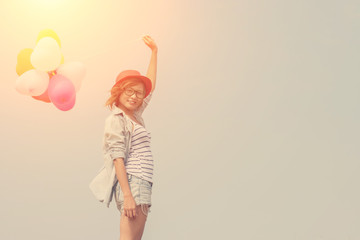 young beautiful woman holding balloon very happy on the fresh ai