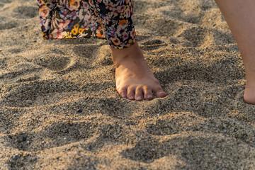 Female feet on beach sands