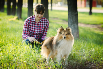 Student girl learning in nature with dog