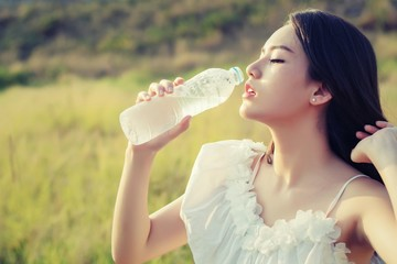 Woman drink water for thirst,dream soft style.