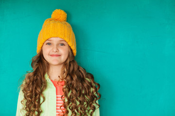 Beautiful little lady in yellow woolen cap