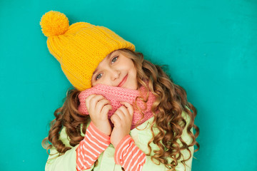 Cute little lady wearing yellow woolen cap and scarf