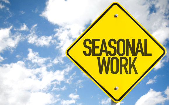 Seasonal Work sign with sky background