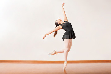 Ballerina performing in a dance studio