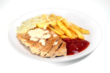 Fried pork / Fried pork and fried potatoes with ketchup on white plate.