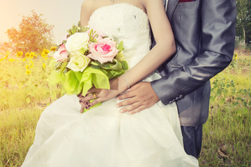Beautiful bouquet of different colors in the hands of the bride