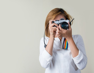 Young pretty girl holding retro camera.
