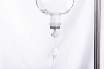 Close up saline IV drip for patient in hospital with copy space