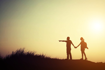 silhouette of couple go to travel together.