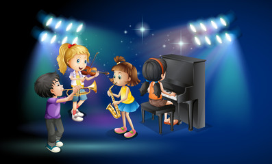 Kids playing music on stage