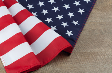 Usa flag folds on walnut wooden table. Horizontal image with copy space.