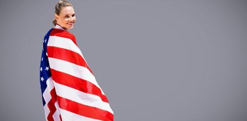 Composite image of portrait of happy american sportswoman posing