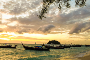 Colorful dawn over the sea with boat.