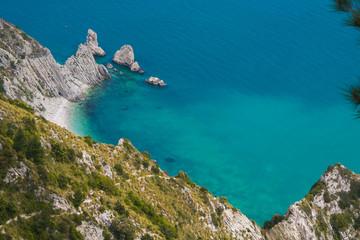 Summer vacation on the adriatic sea. Panoramic view of la spiaggia delle due sorelle, Monte Conero, Italy.