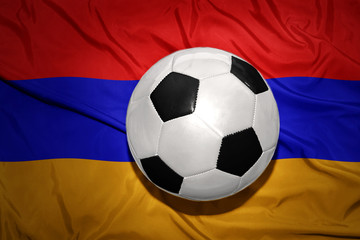black and white football ball on the national flag of armenia