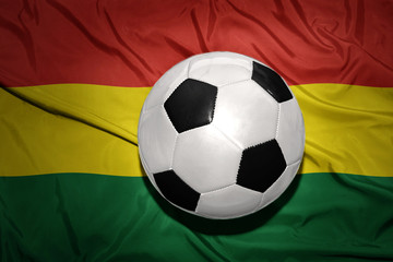 black and white football ball on the national flag of bolivia
