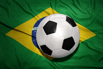 black and white football ball on the national flag of brazil